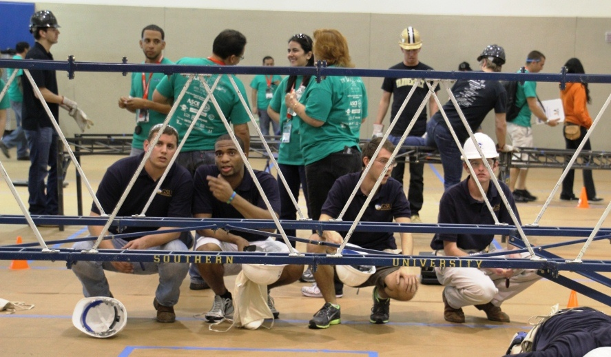Georgia Southern University students assessing their entry in the Steel Bridge competition