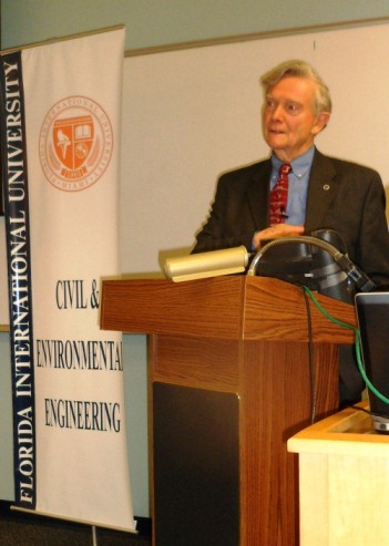 John W. Fisher, Ph.D., delivering a Distinguished Speaker presentation at FIU