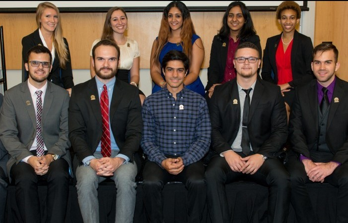 "Photo by FIU News: ""This year's DOE Fellows at an induction ceremony in November."""
